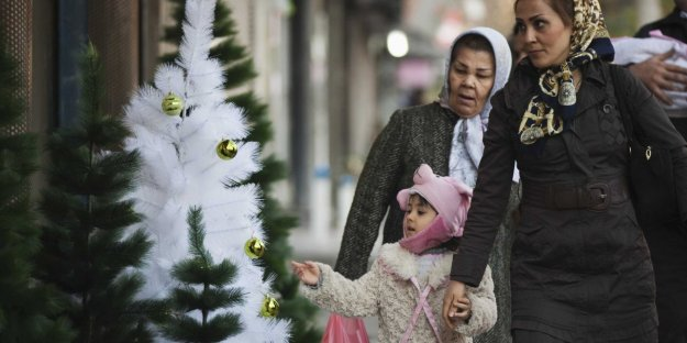 Iranian mother, daughter and some christmas trees