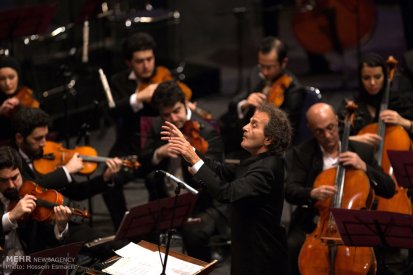 Tehran, Iran - Shahrdad Rohani conducts orchest in Tehran 2015 Jan 16