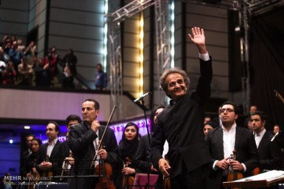 Tehran, Iran - Shahrdad Rohani conducts orchest in Tehran 2015 Jan 22