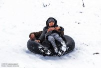 Iran, North Khorasan province, Mahnan village near Bojnourd Families Sliding on Snow 02