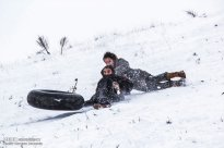 Iran, North Khorasan province, Mahnan village near Bojnourd Families Sliding on Snow 03