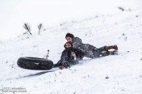 Iran, North Khorasan province, Mahnan village near Bojnourd Families Sliding on Snow 03
