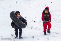 Iran, North Khorasan province, Mahnan village near Bojnourd Families Sliding on Snow 04