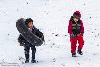 Iran, North Khorasan province, Mahnan village near Bojnourd Families Sliding on Snow 04