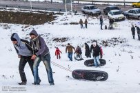 Iran, North Khorasan province, Mahnan village near Bojnourd Families Sliding on Snow 06