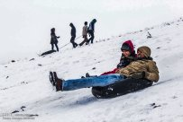 Iran, North Khorasan province, Mahnan village near Bojnourd Families Sliding on Snow 07