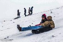 Iran, North Khorasan province, Mahnan village near Bojnourd Families Sliding on Snow 07