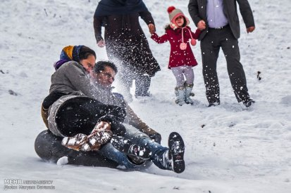 Iran, North Khorasan province, Mahnan village near Bojnourd Families Sliding on Snow 09