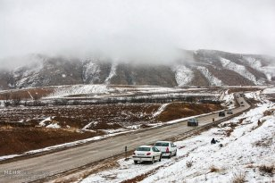 Iran, North Khorasan province, Mahnan village near Bojnourd Families Sliding on Snow 10