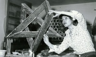 Monir Shahroudy Farmanfarmaian in her studio working on Heptagon Star, Tehran, 1975 Photo: Courtesy of the artist and The Third Line, Dubai