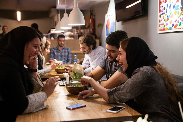 Young couples enjoy a meal in a western style restaurant in Tehran. Photographer: Simon Dawson/Bloomberg