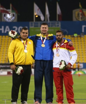 2015 IPC Athletics World Championships - F12 Men's Shot Put - Medalists Roman Danyliuk, Ukraine (Gold), Saman Pakbaz, Iran (Silver), Kim Lopez Gonzalez, Spain (Bronze)