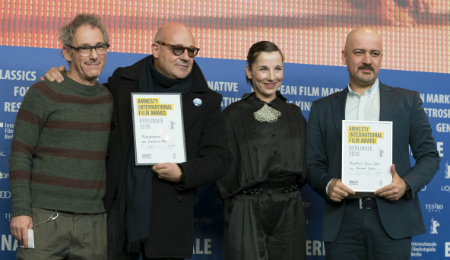 Iranian filmmaker Mehrdad Oskouei (1st R) and Italian director Gianfranco Rosi (2nd L) with Jury members Dani Levy (1st L) and Meret Becker (2nd R) in Berlin - Feb 20, 2016. Photo credits: Henning Schacht / Amnesty International