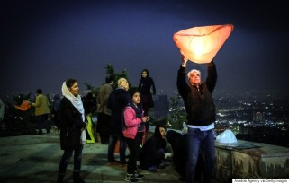 TEHRAN, IRAN - MARCH 15: An Iranian man flies a sky lantern during the celebrations of Chaharshanbe Suri on the eve of the last Wednesday of the year before Nowruz, in Tehran, Iran on March 15, 2016. (Photo by Fatemeh Bahrami/Anadolu Agency/Getty Images)