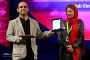 "Iranian director Mehdi Ghorbanpour winner of the Interfaith Award for ""Zemnaco"" at the 34th Fajr International Film Festival held at Tehran's Vahdat Hall, Iran (Photo credit: Vahid Khodadi / Azad News Agency)"