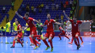 Iran futsal team celebrates after winning on penalty kicks against Brazil at the FIFA Futsal World Cup 2016 in Colombia (Photo by Victor Decolongon - FIFA via Getty Images)