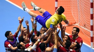 Iran's team players throw in the air Brazilian player Falcao as they celebrate their victory over Brazil at the FIFA Futsal World Cup 2016 in Colombia (Photo by Guillermo Legaria - AFP)