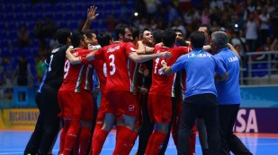 Team Iran celebrate on the court after their quarterfinal match against Paraguay at the 2016 FIFA Futsal World Cup in Colombia (Photo by Victor Decolongon - FIFA via Getty Images)