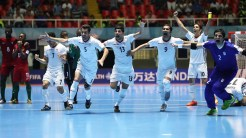 Iran futsal team celebrates after winning on penalty kicks against Portugal at the FIFA Futsal World Cup 2016 in Colombia (Photo by Ian MacNicol - FIFA via Getty Images)