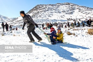 Winter joys - Snow sliding in Iran (Photo credit: Majid Nouri, ISNA)