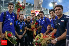Iranian team welcomed at the airport in Tehran. Photo credit BORNA