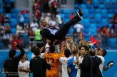 Iranian players celebrate their victory by throwing head coach Carlos Queiroz in the air after their match against Morocco in St. Petersburg Stadium, Russia (photo credit Mohammadreza Abbasi, MEHR)