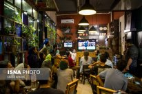 Iranian fans watching the match in a café in Tehran. Photo credit: Hamid Amlashi, ISNA.