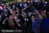 Iranian fans celebrating the victory of their team at Tajrish Square in Tehran. Photo credit: Atiyeh Niknam, Tehran Picture Agency.