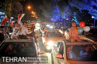 Iranian fans celebrating the victory of their team in Tehran. Photo credit: Shayan Mehrabi, Tehran Picture Agency.