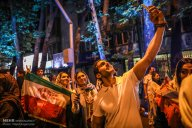 Iranian fans celebrating the victory of their team in Tehran. Photo credit: Majid Asgaripour, MEHR News Agency.