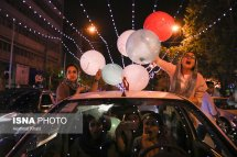 Iranian fans celebrating the victory of their team in Tehran. Photo credit: Hemmat Khahi, ISNA.